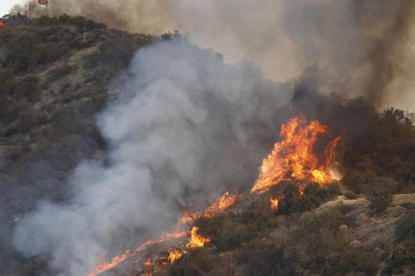 Deadly California wildfires force 250,000 people to flee their homes