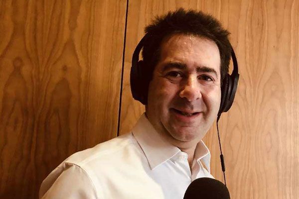 Travel.Radio signs travel commentator Paul Charles as presenter