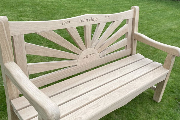 Hays Travel homeworkers club together for memorial bench for John Hays
